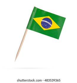 Miniature paper flag Brasil. Isolated Brasilien flag pointer on white background. With shadow below
