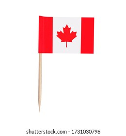 Miniature paper flag Canada. Isolated Canadian toothpick flag pointer on white background.