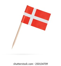 Miniature paper flag Denmark. Isolated on white background.With shadow below