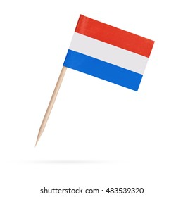 Miniature paper flag Netherlands , Holland. Isolated mini Dutch flag pointer on white background. With shadow below