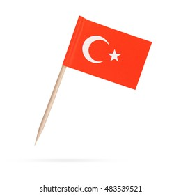 Miniature paper flag Turkey. Isolated mini Turkish flag on white background. With shadow below