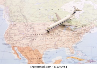 Miniature of a passenger airplane flying on the map of United States of America from north east. Conceptual image for travel and tourism