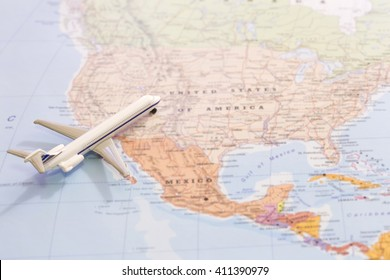 Miniature of a passenger airplane flying on the map of United States of America from south west. Conceptual image for travel and tourism