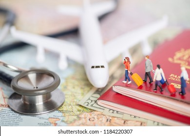 Miniature passenger concept of people travel to foreign land - insurance or medical tourism concept.