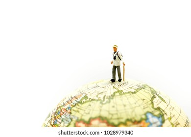 Miniature people :  backpacker and tourist people standing on world map,travel concept.