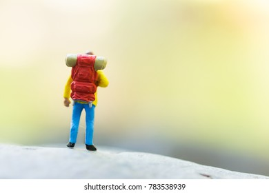 Miniature people, backpackers walking on the stones at river. Travel Lifestyle adventure vacations concept
