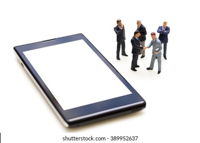 Miniature People Business Concept : Businessmen Handshaking For Agreement With Blank Mobile Phone