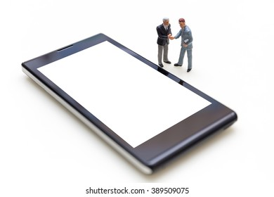 Miniature People Business Concept : Two Miniature Businessmen Handshaking For Agreement With Blank Mobile Phone