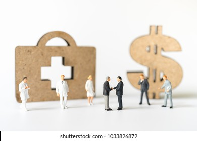 Miniature people, Business man dealing successful contract with doctor and nurse on white background. Health care, life insurance travel hospitality concept.
