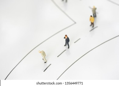 Miniature people: business man making decision on the road. Success, dealing, greeting and partner concept.