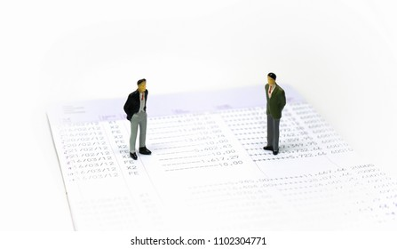 Miniature people : Business man standing on bankbook, Business finance concept.