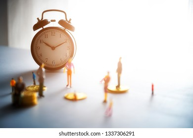 Miniature people: Business man standing on coins