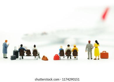 Miniature people : Business team waiting for airplane with copy space for travel, business trip traveler adviser agency or online world wide marking concept.