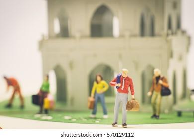 Miniature people businessman prepare travel