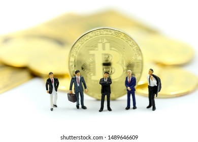 Miniature people : Businessman team with Bitcoins ,credit card  of dollar banknote,Digital money cryptocurrency concept.
