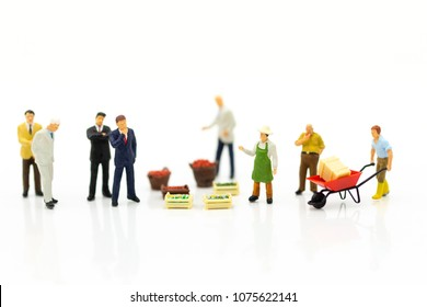 Miniature people : Businessman team Investment in trading business. Image use for marketing, merchant middleman,retail business concept.