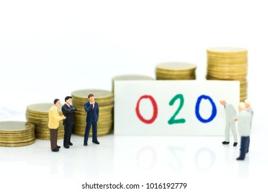Miniature people : Businessman think of a new solution to Online to Offline (O2O) business, create idea of marketing. Image use for retail business, online marketingplace concept.