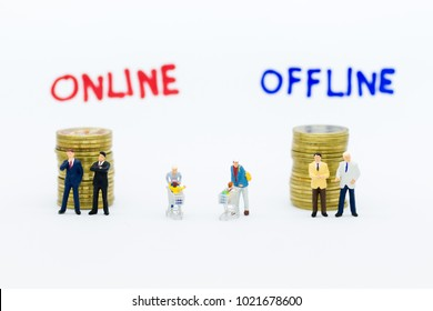 Miniature people : Businessman think of a Online and Offline Business Options. Image use for retail business, marketing place concept.