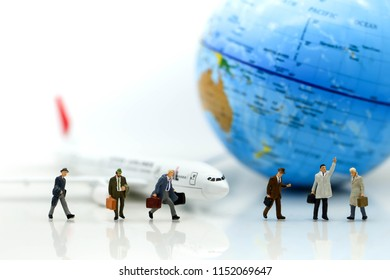 Miniature people : businessman waiting for a taxi in front of the airport,business meeting concept.