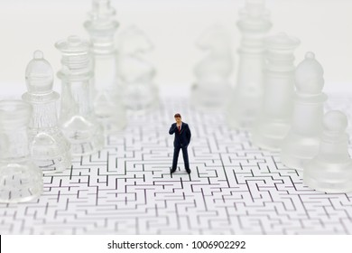 Miniature people, Businessmen standing on the chess game, find the solution for the business game,  use as a business competition concept.