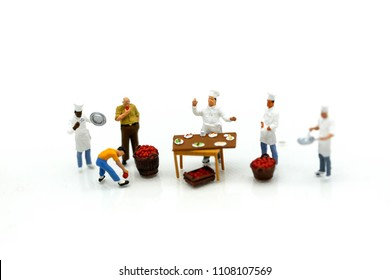 Miniature people : chef and people buying fruits and vegetables in a farmers market.