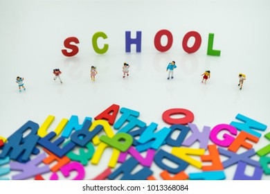 Miniature people: children with colorful text school, education with copy space using as background learning, education concept.
