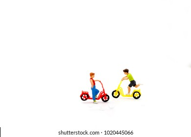 Miniature people children playing on Bicycle, happy family day concept.