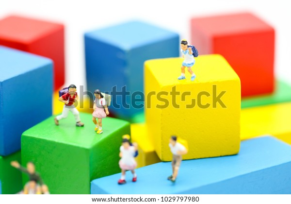 Miniature people : children and student  with colour wooden block,play and education concept.