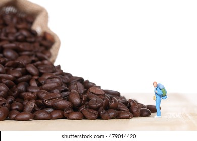 miniature people with coffee beans.