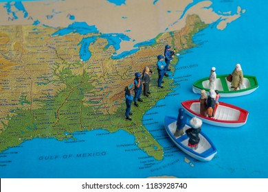 Miniature people concept of Middle Eastern people arrive by boat to the border of USA.