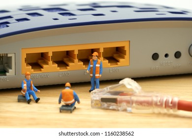 Miniature people Construction worker LAN connection Or connect to the internet. Communication ideas, maintenance.