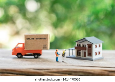 Miniature people Construction worker Online shopping with a shopping cart and shopping bags delivery service using as background shopping concept and delivery service concept with copy space