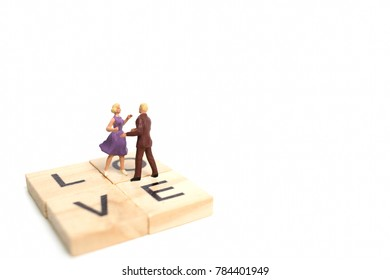 Miniature people, Couple romantic dancing on white background , Valentine's day concept