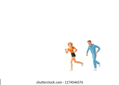 Miniature people : Couple running on white background , Healthy lifestyle and sport concepts.
