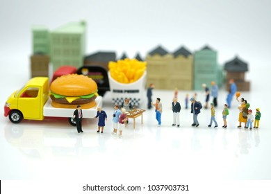 Miniature People : Customer waiting to buy meal from  mobile food truck use as franchise , food business concept.