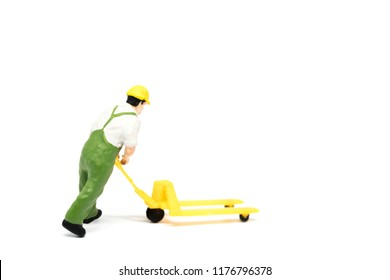 Miniature people delivery worker concept on white background with a space for text