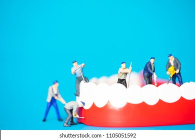 Miniature people : Dental model clean and Root canal treatment.Dental care clinic and teamwork concept.