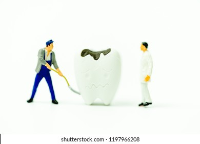Miniature people : Dentist model clean tooth decay and Root canal treatment.Dental care clinic, Dentist and  tooth decay concept.