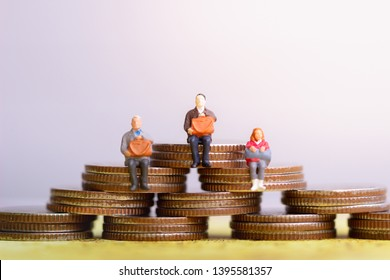 Miniature people: Elderly people sitting on coins stack. Retirement planning. money saving and Investment. Time counting down for retirement concept.
