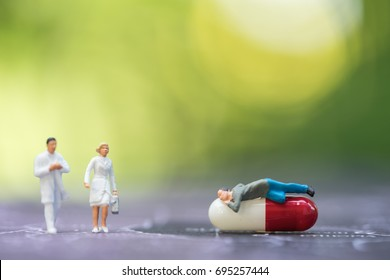 Miniature people, emergency medical team in front of stethoscope on world map. Concept of health care, emergency, life insurance, accident background
