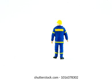 Miniature people engineer worker construction concept on white background
