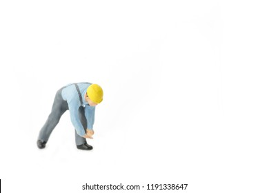 Miniature people engineer worker construction concept on white background with a space for text