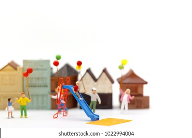 Miniature people, family and children enjoy with colorful balloons, happy family day concept.