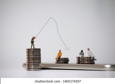 Miniature people fishing and piles of coins on the smartphone. The concept of voice phishing.
