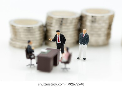 Miniature people: Group business meeting guaranteed loan, third party, guarantor. Image use for business concept.