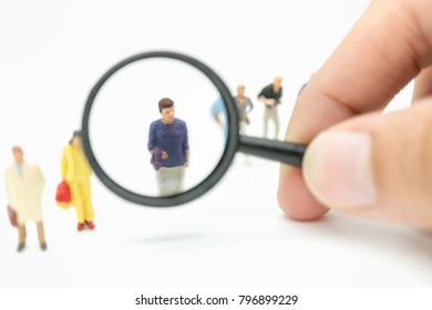 Miniature people: Group of business team standing on white background with binoculars using as recruitment choice of the best suited employee, HR, HRM, HRD, job recruiter concepts.