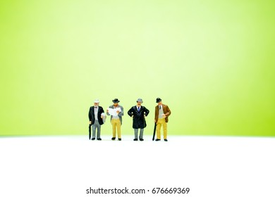 Miniature people, group of old businessman using as business concept
