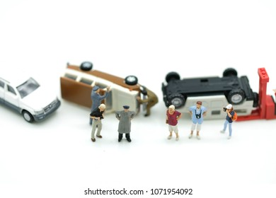 Miniature people : Group of people standing beside the car accident , repaire and rescure concept.