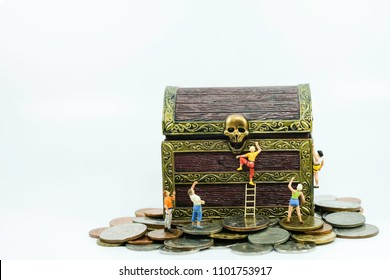 Miniature people : Group of tourist climbing the treasure chest use as prirate and way to success concept