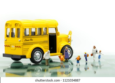 Miniature people : A group of young children getting on the schoolbus,schoolbus transportation education